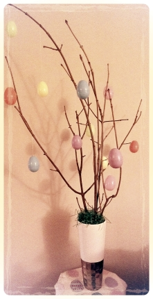 Step 2: Tie plastic Easter eggs to tree branches