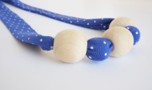 blue polka dot bamboo fabric natural wood chew bead teething necklace by Running Wild Designs